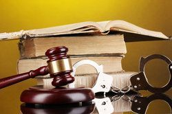 books, cuffs, gavel