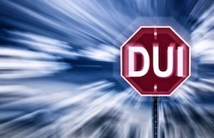 Blurred image of a sign that reads DUI.