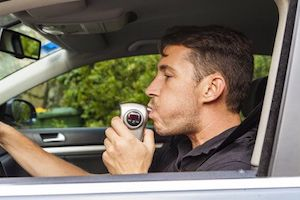Man blowing into a breathalyzer