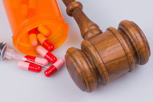 Prescription medication and a gavel.