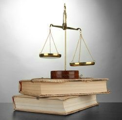 scales of justice on a pair of old books